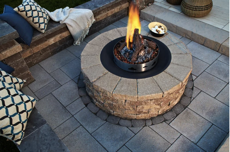 Circular Valencia fireplace by Techo-Bloc, with cobble stone and wonderful interlocking accents.