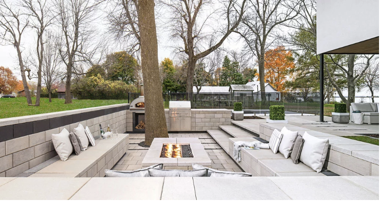 Blended in with nature, the raffinato line from Techo-Bloc creates a mature and formal modern ambiance amongst a rustic setting.